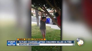 Father charged after children killed in house fire - Video