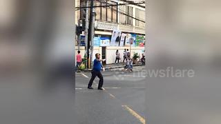 Policeman dances non-stop for ages while directing traffic at busy junction - Video