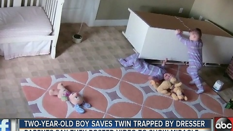 Two-year-old boy saves twin trapped under dresser