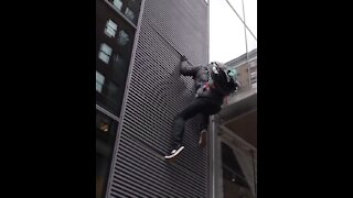 Left Wing Protestor FALLS While Trying to Climb NYC Building