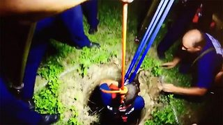 Incredible footage shows hero firefighters rescuing dog from 30ft well