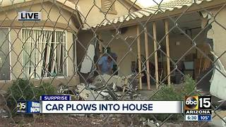Car plows into Surprise home injuring driver