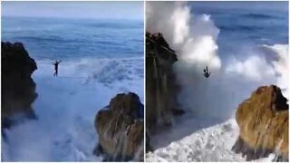 Man defies death slacklining over giant waves in Portugal