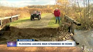 Flooding leaves man stranded in home - Video