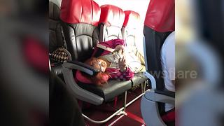 Woman angers plane passengers by laying across premium seats on AirAsia flight - Video
