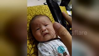 Baby stops crying when he is given his own medicine
