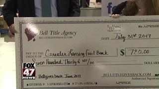 Business presents check to Greater Lansing Food Bank - Video