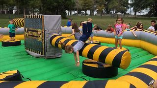 Girl Epically Fails At Inflatable Obstacle Course - Video