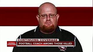 Coach dies after heroically shielding students from gunfire in Florida school shooting - Video
