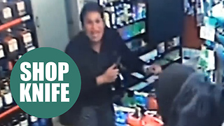 female corner shop worker confronts a knifeman with her own blade - Video