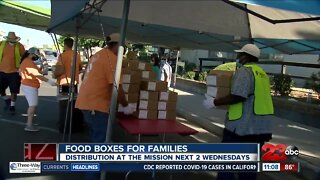 The Mission distributes food boxes for families