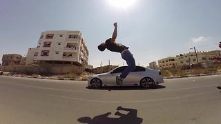 Daredevils pull off high-flying stunts with speeding cars