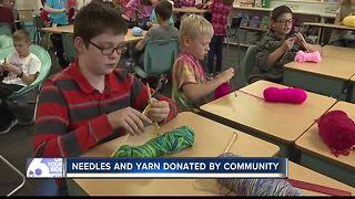 Fifth-graders knit scarves for the homeless - Video