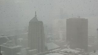 Lake-Effect Snow Swirls Through Chicago - Video