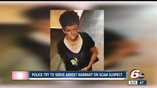 Police try to serve arrest warrant on scam suspect - Video