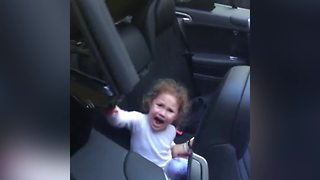 A Little Girl Freaks Out Because She Thinks That A Convertible Car Will Eat Her - Video