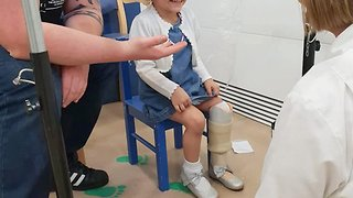 Toddler filmed receiving first prosthetic after parents chose to amputate her leg