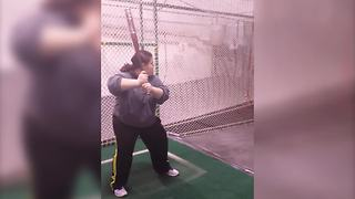 Funny Girl Practices Her Baseball Swings