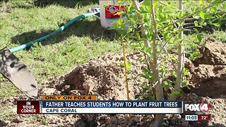 Father teaches students hot to plant fruit trees