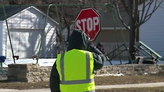 Police: Crossing guard job comes with vaccine eligibility