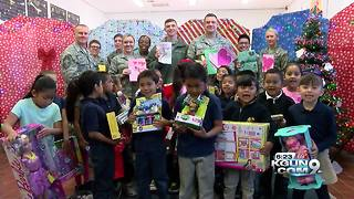 """Santas in Blue"" donate Christmas gifts to Tucson kids - Video"