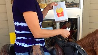 Woman rides on horse for McDonald's drive-thru