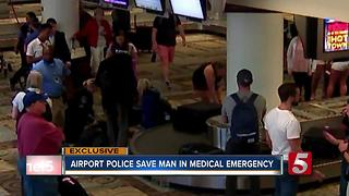 Airport Police Save Man From Medical Emergency - Video