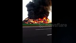 Two lorries burst into flames after China motorway collision - Video