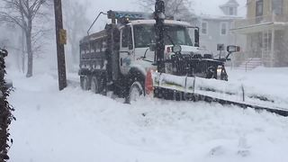 Snow ploughs clear Boston during massive storm - Video
