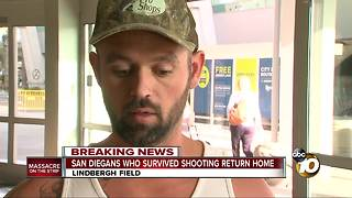 San Diegans who survived shooting return home - Video
