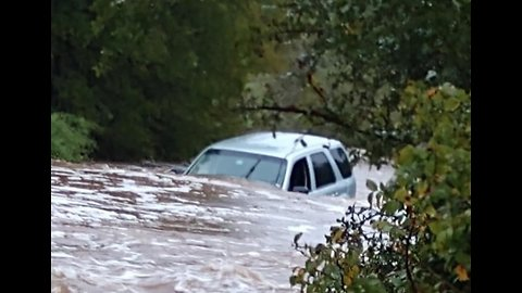 Car Stranded in Rushing Water During Flooding in Marble Falls, Texas