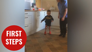 Brave three-year-old meningitis survivor takes his first steps on prosthetics - Video