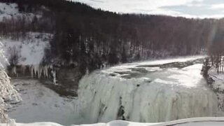 Drone footage of frozen New York waterfall