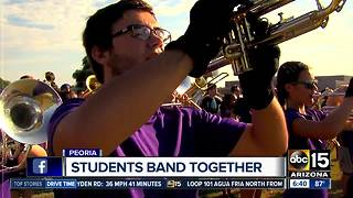 Peoria band students raising money for truck to haul instruments - Video