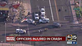 Two officers, woman hurt after Phoenix crash - Video