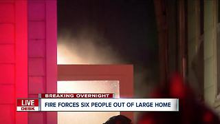 Fire forces seven people out of Buffalo home - Video