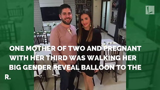Mom Carrying Gender Reveal Balloon Doesn't See Toddler Sneaking Up Behind Her with Toy Sword - Video