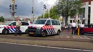 Police Close Amsterdam Street After Hand Grenade Found in Doorway - Video