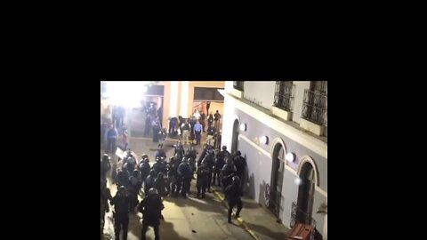 Police Gather Behind Barricade as Protesters Rally Against Governor Ricardo Rosselló in San Juan