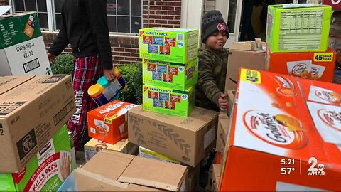 7-year-old starts 'Love is greater than COVID-19' food pantry to help families struggling