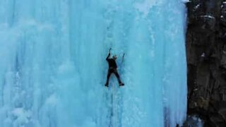 Mountaineers climb frozen waterfall
