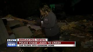 Truck plows through two homes after chase