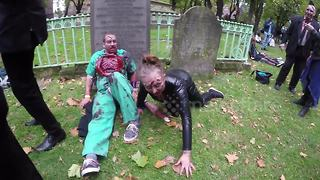 Zombies walk through the streets of London for charity - Video