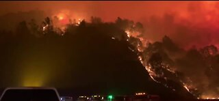 CA wildfires kill at least 10 people, with a dozen missing