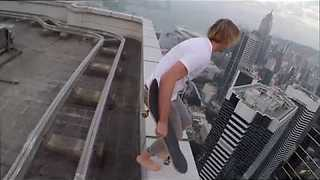 Daredevil Skateboarder Rides On The Edge Of A Skyscraper Roof - Video