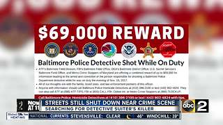 Police continue to search for gunman after Baltimore detective shot - Video