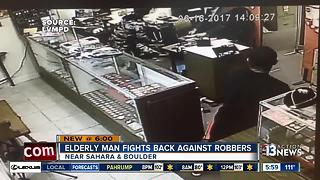 Elderly man fights back against robbers - Video