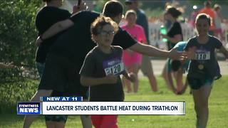 Lancaster students battle heat during triathlon - Video