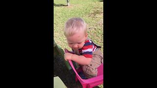 One-year-old drops F-bomb after getting foot stuck in chair