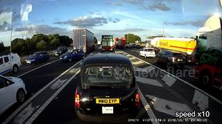 Drivers caught in motorway traffic begin U-turning en masse - Video
